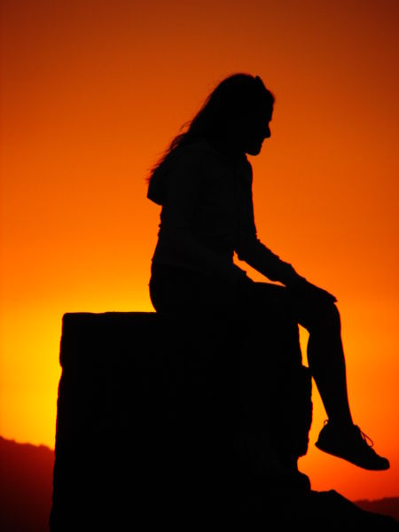 Woman sitting sunset